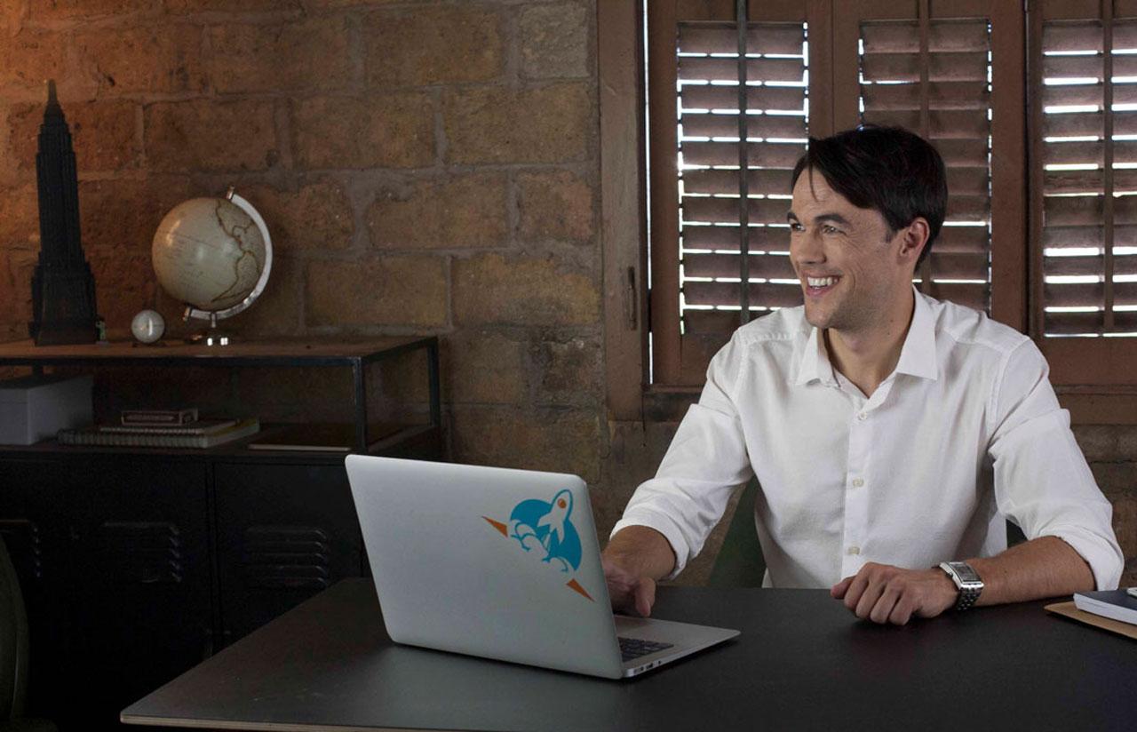 Matthew Pollard working on a laptop at a desk