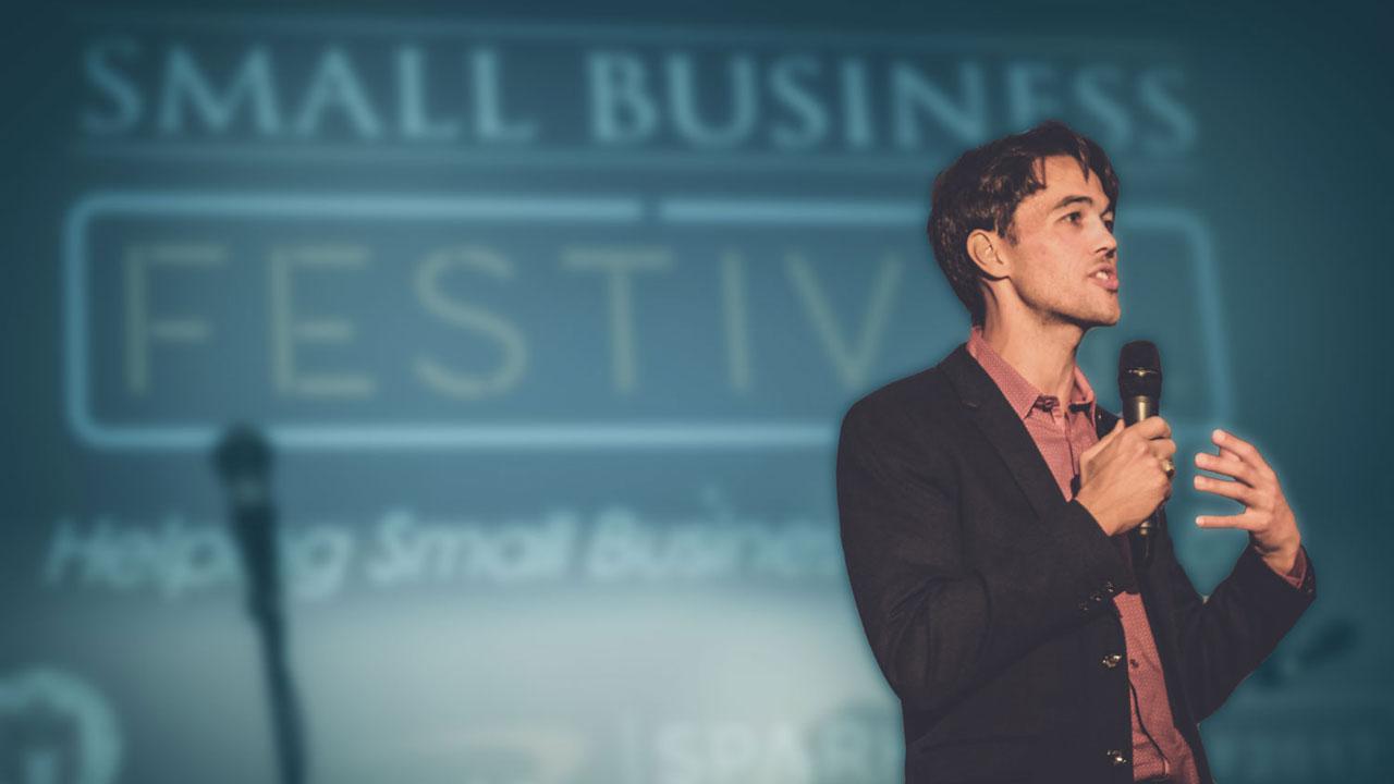 Matthew Pollard speaking on stage