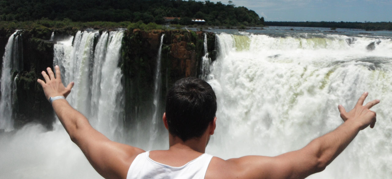 Matthew looking out over a waterfall
